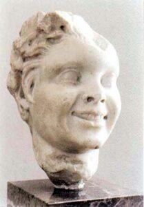 Figura 200 - Testa di satiro giovane, sec. II. Museo Archeologico di Tarragona. (Spagna).